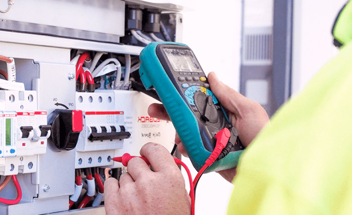 solar inverter being repaired by technician